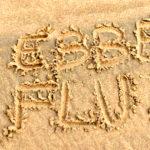 Ebbe und Flut in den Sand geschrieben