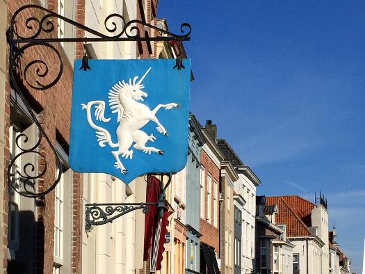 Historische Werbetafel in Heusden, Einhorn